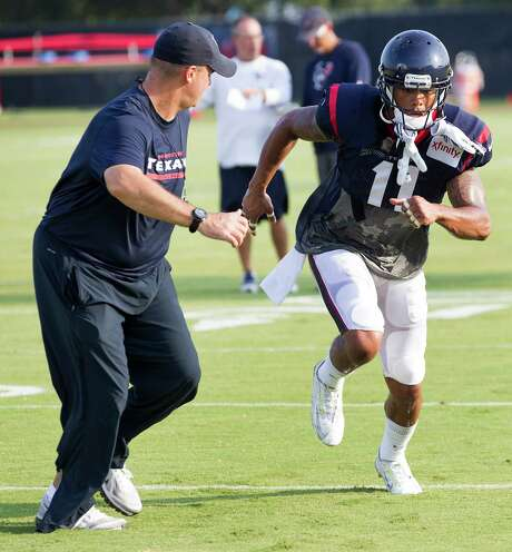 """Coach Bill O'Brien, left, has noticed that the tireless DeVier Posey is """"working at it."""" Photo: Brett Coomer, Staff / © 2014 Houston Chronicle"""