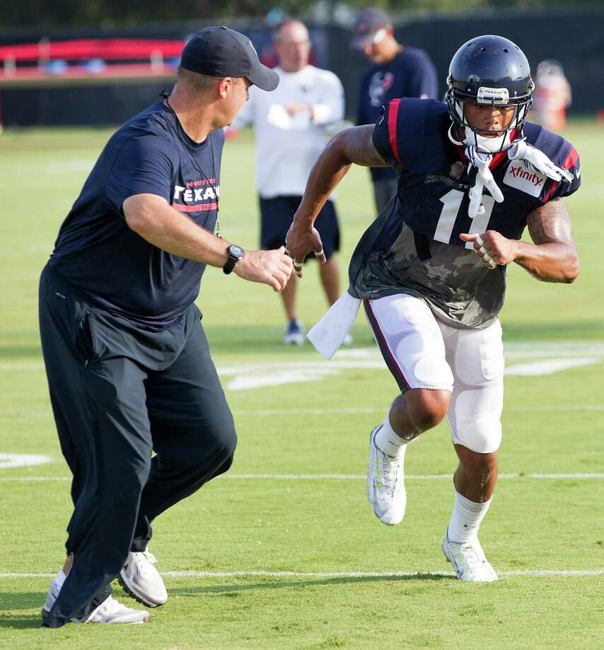 "Coach Bill O'Brien, left, has noticed that the tireless DeVier Posey is ""working at it."" Photo: Brett Coomer, Staff / © 2014 Houston Chronicle"