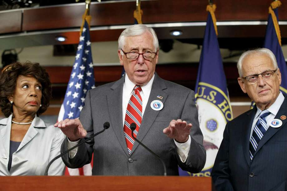 House Minority Whip Steny Hoyer of Md., joined by Rep. Maxine Waters, D-Calif., left, and Rep. Kerry Bentivolio, R-Mich., criticizes the efforts of Republicans to muscle legislation through the House authorizing an election-year lawsuit against President Barack Obama that accuses him of exceeding his powers in enforcing his health care law, Wednesday, July 30, 2014, during a news conference on Capitol Hill in Washington. Democrats have branded the effort a political charade aimed at stirring up Republican voters for the fall congressional elections. They say it's also an effort by top Republicans to mollify conservatives who want Obama to be impeached — something House Speaker John Boehner of Ohio, said Tuesday he has no plans to do.  (AP Photo/J. Scott Applewhite) Photo: J. Scott Applewhite, STF / AP