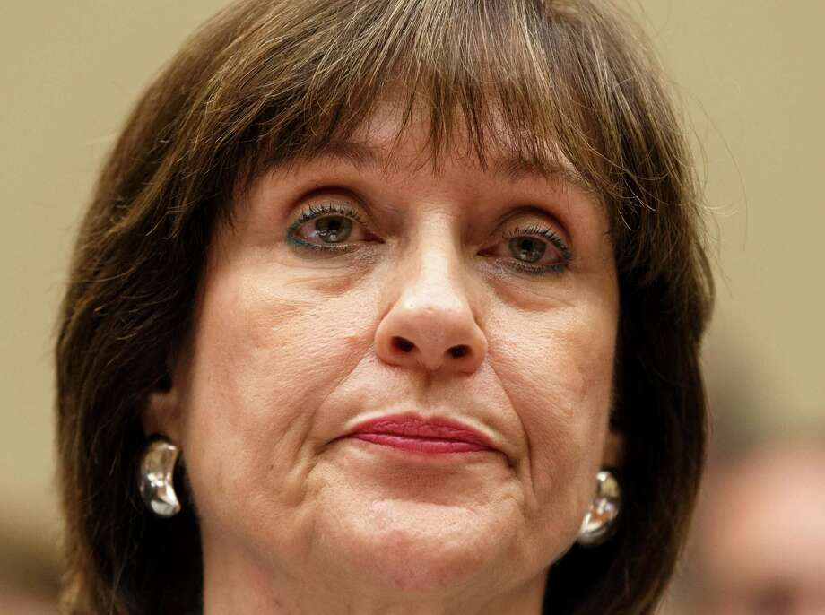 "FILE - In this May 22, 2013 file photo, Internal Revenue Service official Lois Lerner refuses to answer questions as the House Oversight Committee holds a hearing to investigate the extra scrutiny the IRS gave Tea Party and other conservative groups that applied for tax-exempt status, on Capitol Hill in Washington. Lerner, a former IRS official at the heart of the agency's tea party controversial called Republicans ""crazies"" and more in newly released emails. Lerner used to head the IRS division that handles applications for tax-exempt status. In a series of emails with a colleague in November 2012, Lerner made two disparaging remarks about members of the GOP, including one remark that was profane. House Ways and Means Committee Chairman Rep. Dave Camp, R-Mich., released the emails Wednesday as part of his committee's investigation. Camp says the emails show Lerner's disgust with conservatives. (AP Photo/J. Scott Applewhite, File) Photo: J. Scott Applewhite, STF / AP"