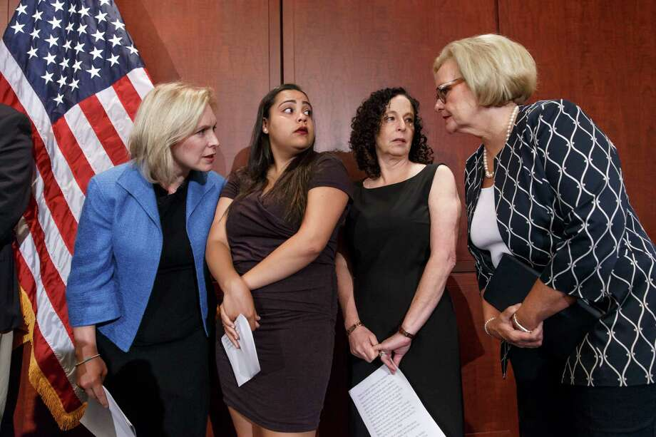 """From left, Sen. Kirsten Gillibrand, D-N.Y., Anna, a survivor of sexual assault, with her mother Susan, and Sen. Claire McCaskill, D-Mo., talk to each other during a news conference on Capitol Hill in Washington, Wednesday, July 30, 2014, to discuss """"Campus Accountability and Safety Act"""" that is before the Senate. Anna was an 18 year old student at Hobart and William Smith Colleges in central New York when she was sexually assaulted by fellow students at a fraternity party, just three weeks into her freshman year. (AP Photo/J. Scott Applewhite) Photo: J. Scott Applewhite, STF / AP"""