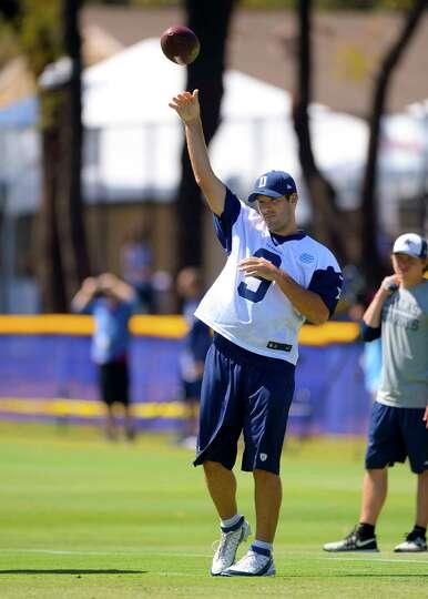 Dallas Cowboys quarterback Tony Romo throws passes during Dallas Cowboy's training camp, Thursday, J