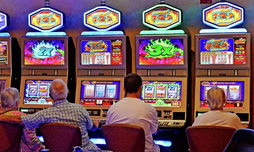Players work the slot machines at Saratoga Casino and Raceway Wednesday afternoon, July 30, 2014, in Saratoga Springs, N.Y. (Skip Dickstein / Times Union)