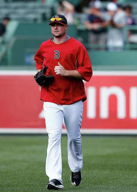Instead of preparing to make his scheduled start, Jon Lester joins the Red Sox on the field before Wednesday's game against the Blue Jays. Lester was scratched amid speculation he will be traded before Thursday's deadline. Photo: Jim Rogash, Stringer / 2014 Getty Images
