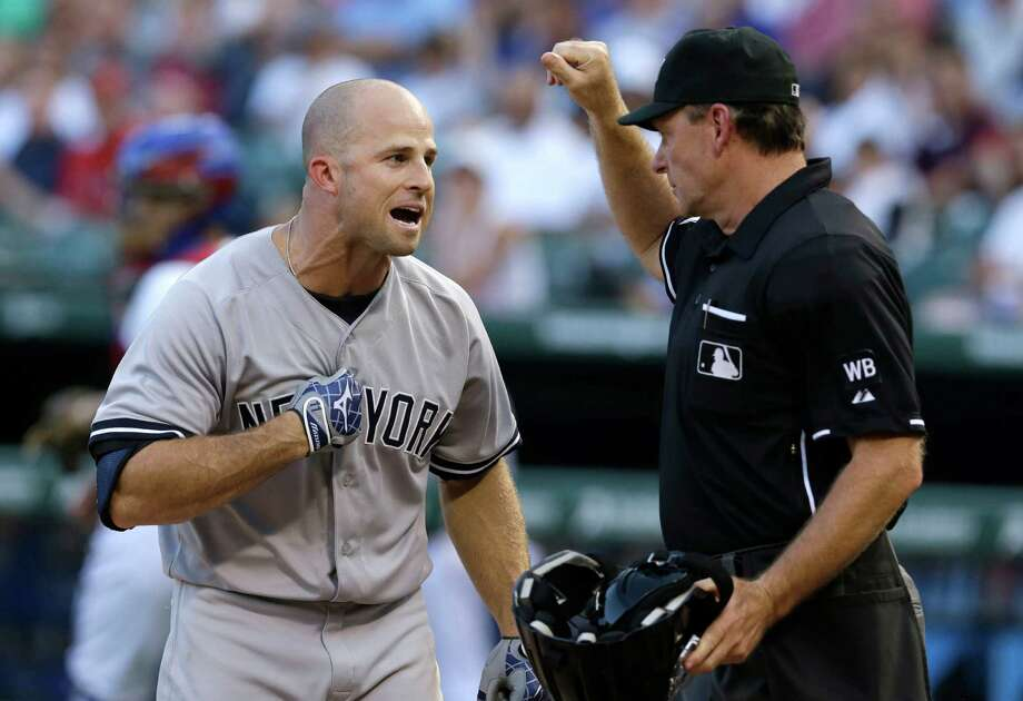 New York Yankees Brett Gardner, left, yells at home plate umpire Ed Hickox  after a strike three call against Gardner during the second inning of a baseball game against the Texas Rangers Wednesday, July 30, 2014, in Arlington, Texas. (AP Photo/LM Otero)   ORG XMIT: ARL110 Photo: LM Otero / AP
