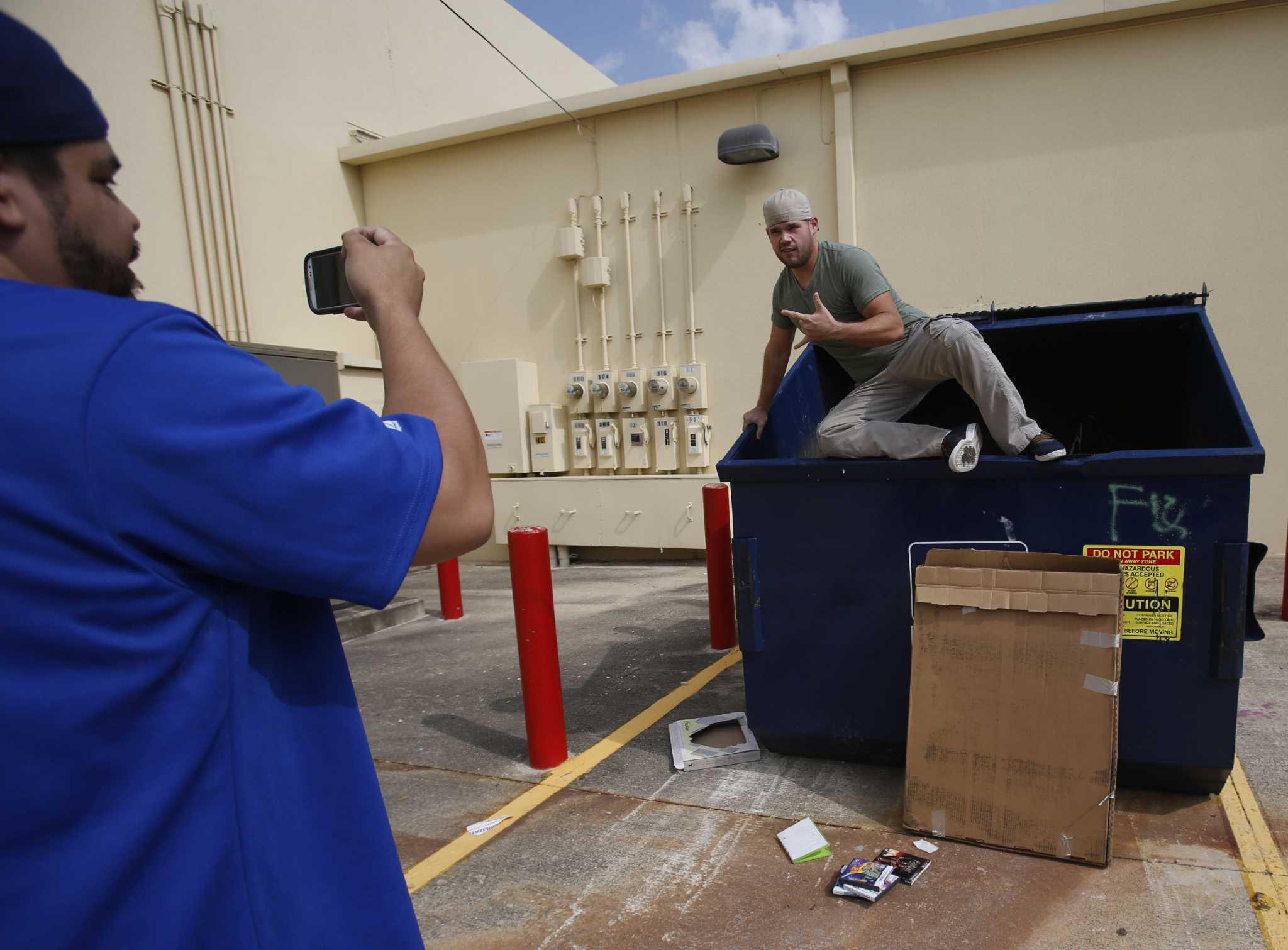 dumpster divers retrieve gaming treasure from the trash san dumpster divers retrieve gaming treasure from the trash san antonio express news