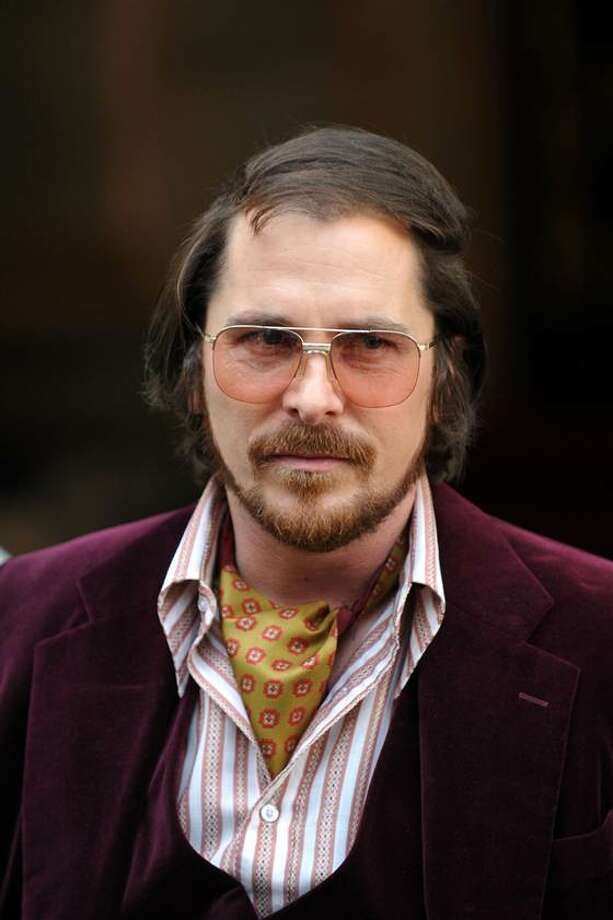 Christian Bale in AMERICAN HUSTLE -- another case of a fictional character not quite being a fictional character.