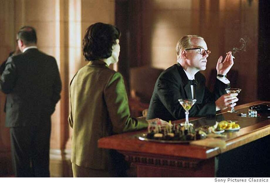 """Philip Seymour Hoffman in """"Capote"""": Looks like him? Enough.  Sounds like him? Oh, yes.  Result:  Triumph. Fascinating performance, a complete immersion into Capote's speech and manner that managed to suggest that this was a great artist and a serious, all-observing mind."""