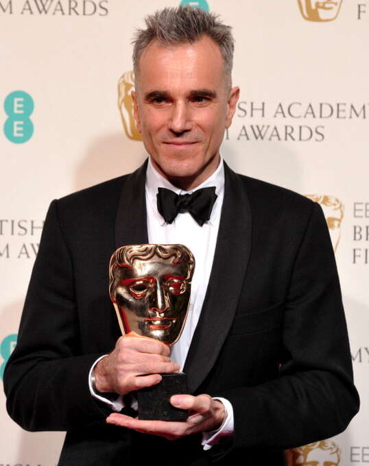 British actor Daniel Day-Lewis poses with his BAFTA award, one of the string of honors he received for playing the title role in LINCOLN.  Of course, we have no moving pictures and no recordings of Lincoln, but Day-Lewis was true to what we know of him -- that he had a high pitched voice -- and he looked just like him. Photo: AFP, AFP/Getty Images / 2013 AFP