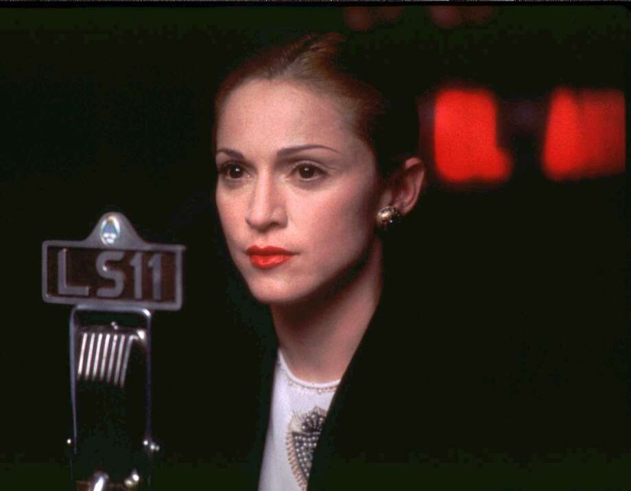 "Madonna as Eva Peron in ""Evita"": Looked like her?  Not exactly.  Sounded like her? Eva Peron didn't sing.  In a sense, the real person Madonna was playing here was Patti Lupone, who had the role on Broadway.  Maodnna is no Patti Lupone, but she can sing and she can dance, and something about this role released her to show something vulnerable for once.  It's a forgotten movie now, an asterisk to a famous stage production, but it probably represents the best thing Madonna will ever do on screen. Photo: HO, REUTERS"