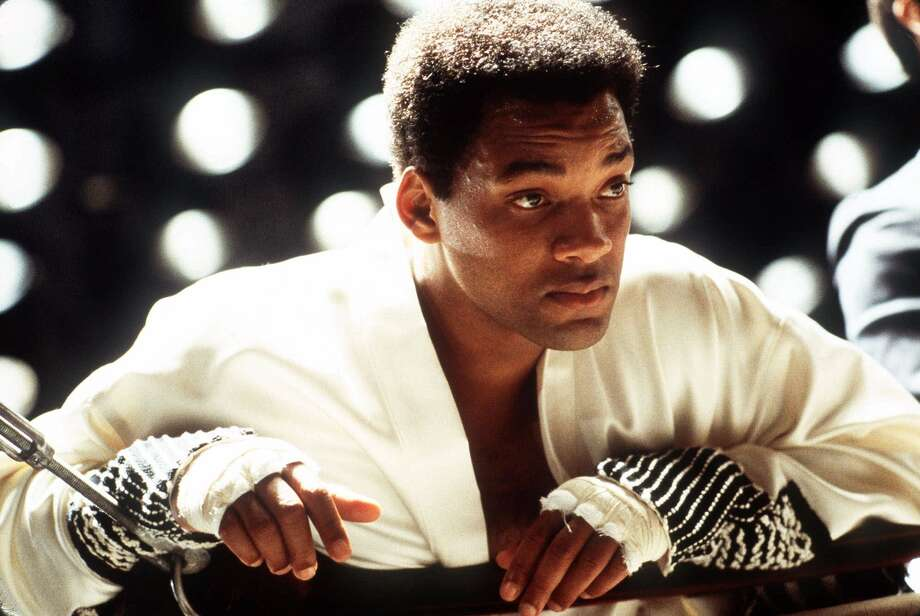 "Will Smith as Ali in ""Ali"":  Looks like him? Almost.  Not as pretty, but what can you expect.  Sounds like him?  Close enough.  Result:  Mixed.  A heroic job, but something in the dangerous essence was lost. Photo: FRANK CONNOR, AP / COLUMBIA PICTURES"