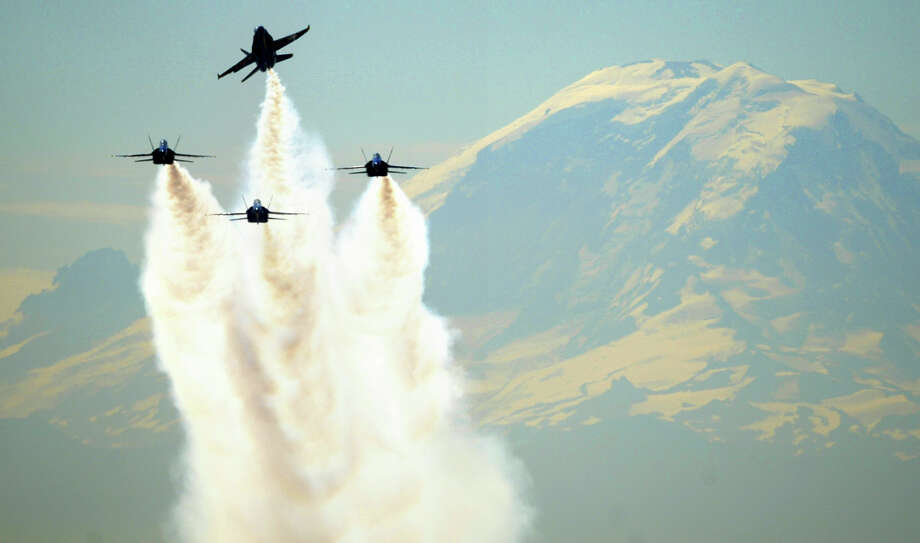 Grassy hill on north end of Boeing Field runway:If it is a clear day, Mount Rainier is a dramatic backdrop for the F/A-18 Hornets as they take off from Boeing Field, assuming they take off headed to the north. Near South Hardy Street and 13th Avenue South. Photo: Seattlepi.com, File