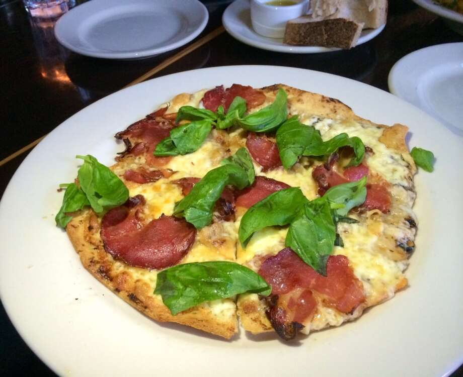 Crisp flatbread is topped with cheese, spicy coppa and basil ($12.50).