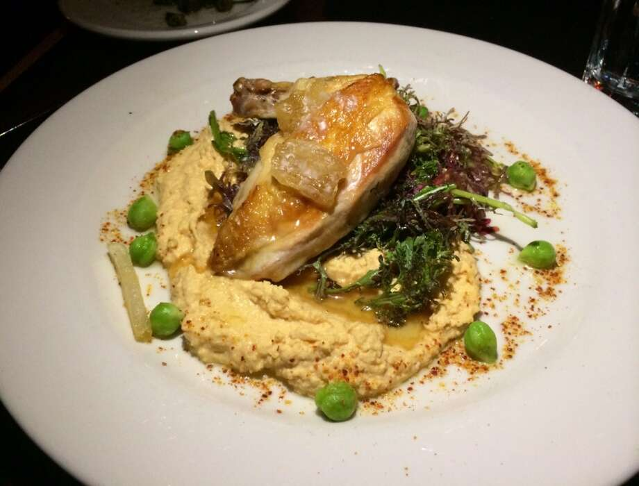 The chicken was in an overly generous nest of hummus, with red mustard greens and honey comb ($22.50).