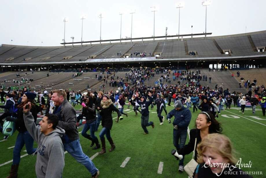 Photo by Soorya Avali: Rice students storm the football field. Photo: Soorya Avali For The Rice Thresher