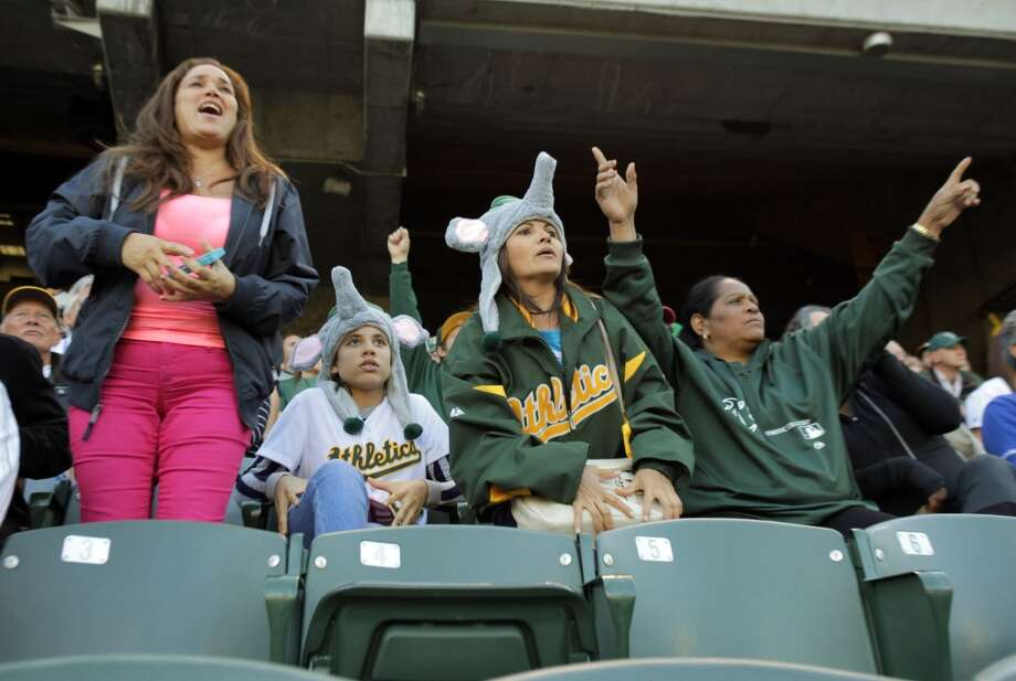 Family of Yoenis Cespedes watch as a ball hit by Yoenis goes to the wall but is caught at the A's game against the Chicago White Sox on Friday, May 31, 2013. (Left to right) Mariela Garcia (cousin's wife), Ivania Ortiz (cousin), Danielys Alvarez (friend) and Estela Milanes (Yoenis's mother). Photo: Carlos Avila Gonzalez, The Chronicle