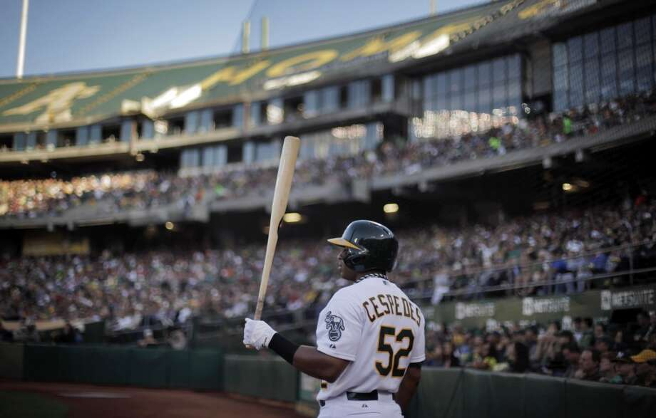 Yoenis Cespedes, of the Oakland Athletics, who was signed by the A's after he left Cuba, before the team's game agains the Boston Red Sox  on Saturday, July 13, 2013, in Oakland. Photo: Carlos Avila Gonzalez, The Chronicle