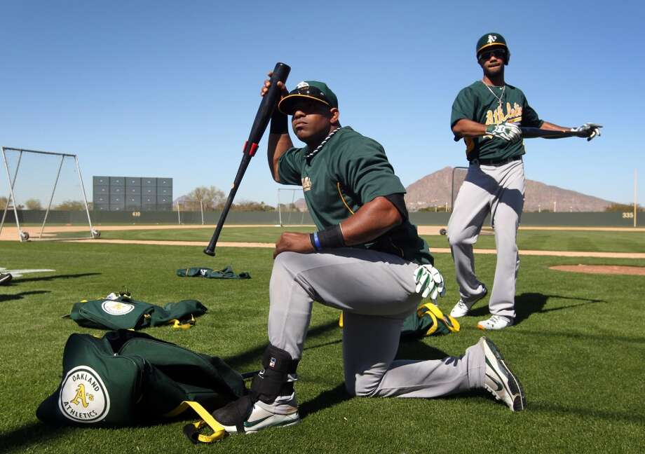 Oakland Athletics' Yoenis Cespedes prepares to take batting practice at spring training Saturday, Feb. 16, 2013, in Phoenix, Ariz. Photo: Lance Iversen, The Chronicle