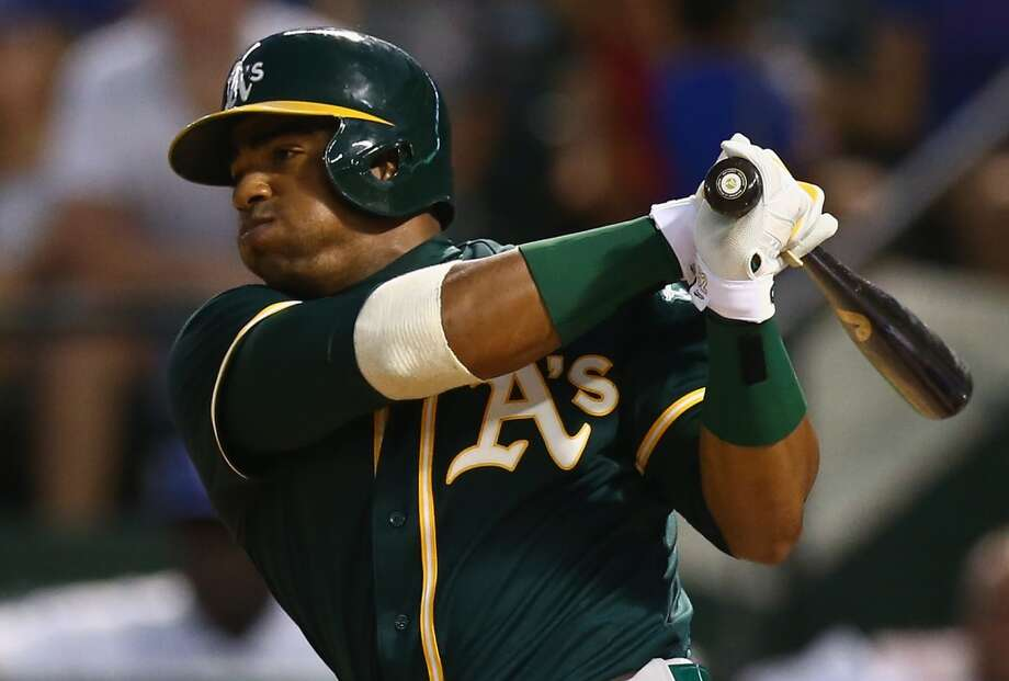 Yoenis Cespedes of the Oakland Athletics hits in a run against the Texas Rangers in the sixth inning at Globe Life Park in Arlington on July 25, 2014 in Arlington, Texas. Photo: Ronald Martinez, Getty Images
