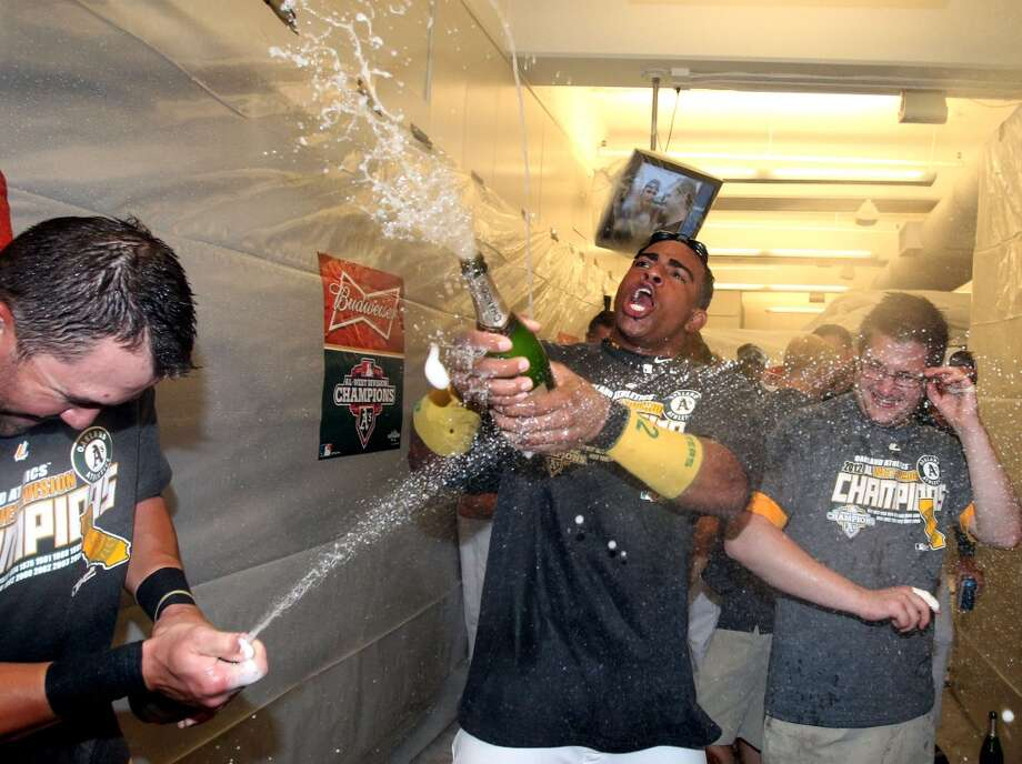 Oakland Athletics Yoenis Cespedes celebrates with his teammates after their 12-5 championship win  over the Texas Rangers Wednesday October 3, 2012 in Oakland. Photo: Lance Iversen, The Chronicle