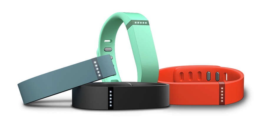 "Fitbit devicesSan Francisco-based Fitbit creates wearable devices that track steps, distance covered, calories burned, and sleep. Users can set daily goals, challenge friends, and earn badges. Fitbit ranges in price from $59.95 for the Zip wireless activity tracker to $249 for the Surge ""super watch."" Photo: Fitbit, ONLINE_YES / ONLINE_YES"