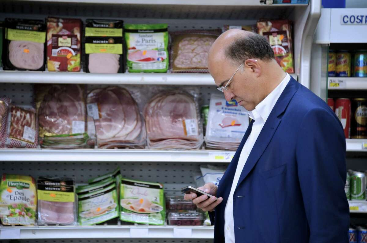 2. Blocking a grocery aisle while you look at your phone.