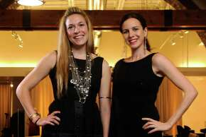 (CM) FE08STBLACK_cm Mary Alice Malone (left) and Sara Neugeberger owners of A.Line Boutique wear their little black dresses in Greenwood Village on Thursday, December 3, 2009. Cyrus McCrimmon, The  (Photo By Cyrus McCrimmon/The Denver Post via Getty Images)
