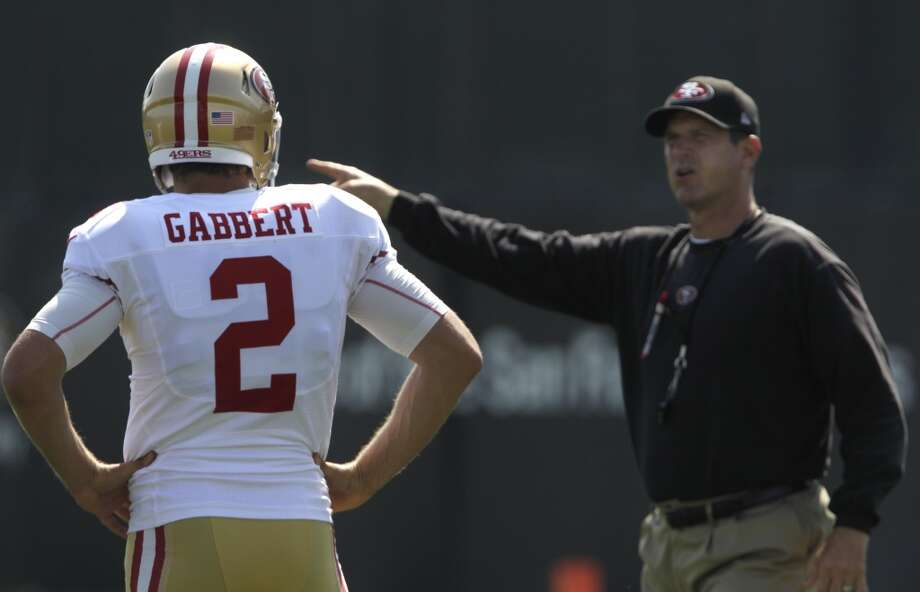 Backup quarterback Blaine Gabbert takes instructions from head coach Jim Harbaugh during the San Francisco 49ers training camp in Santa Clara, Calif. on Tuesday, July 29, 2014. Photo: The Chronicle