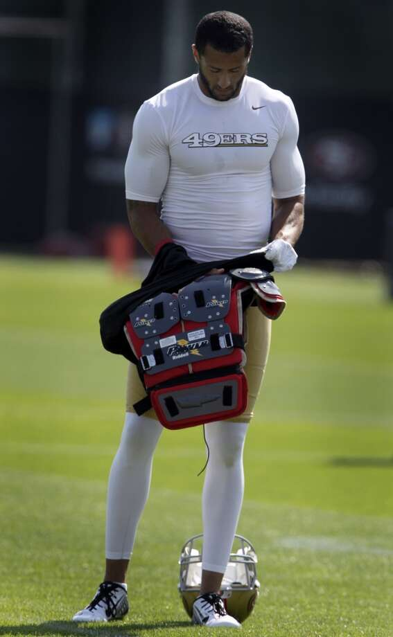 Quarterback Colin Kaepernick puts on his equipment during the San Francisco 49ers training camp in Santa Clara, Calif. on Tuesday, July 29, 2014. Photo: The Chronicle
