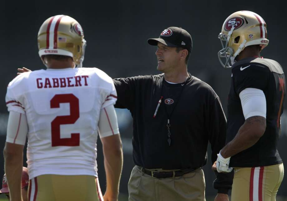 Head coach Jim Harbaugh works with quarterbacks Blaine Gabbert and Colin Kaepernick during the San Francisco 49ers training camp in Santa Clara, Calif. on Tuesday, July 29, 2014. Photo: The Chronicle