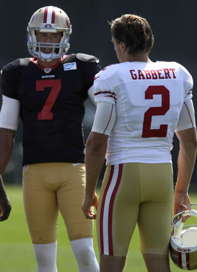 Backup quarterback Blaine Gabbert listens to Colin Kaepernick during the San Francisco 49ers training camp in Santa Clara, Calif. on Tuesday, July 29, 2014. Photo: The Chronicle