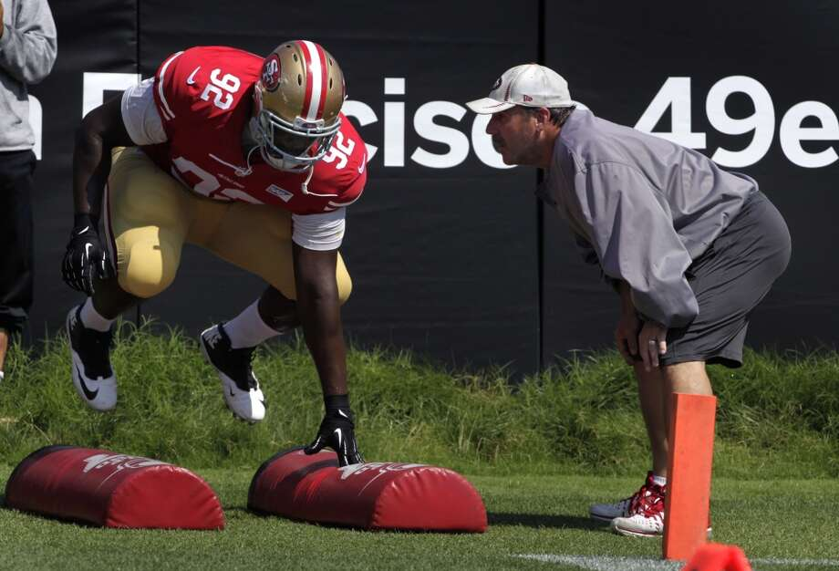 Defensive tackle Quentin Dial goes through a drill with defensive line coach Jim Tomsula during the San Francisco 49ers training camp in Santa Clara, Calif. on Tuesday, July 29, 2014. Photo: The Chronicle