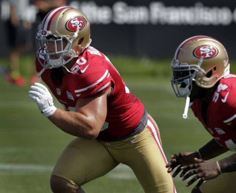 Linebacker Chris Borland (50) practices with teammate Nick Moody during the San Francisco 49ers training camp in Santa Clara, Calif. on Tuesday, July 29, 2014. Photo: The Chronicle