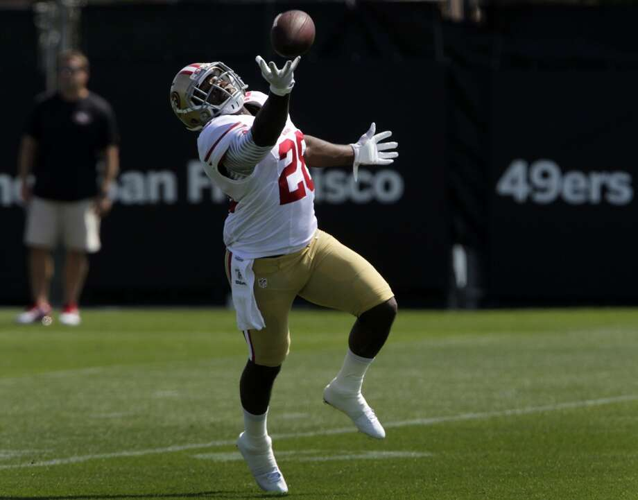 Rookie running back Carlos Hyde, a 2nd round draft pick out of Ohio State, reaches for a pass during the San Francisco 49ers training camp in Santa Clara, Calif. on Tuesday, July 29, 2014. Photo: The Chronicle