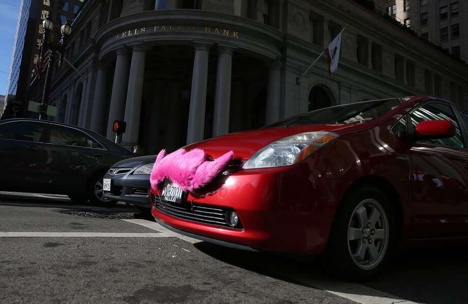 A Lyft car drives along Montgomery Street on January 21, 2014 in San Francisco, California.(Photo by Justin Sullivan/Getty Images) Photo: Justin Sullivan, Getty Images