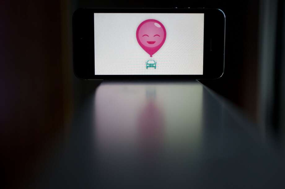 The Lyft Inc. application is displayed on an Apple Inc. iPhone 5s for an arranged photograph in Washington, D.C. on Wednesday, July 9, 2014. (Andrew Harrer/Bloomberg) Photo: Andrew Harrer, Bloomberg