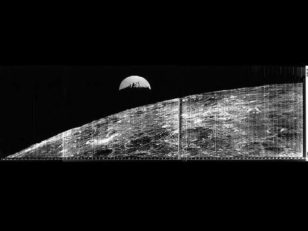 The world's first view of Earth taken by a spacecraft from the vicinity of the Moon. The photo was transmitted to Earth by the United States Lunar Orbiter I and received at the NASA tracking station at Robledo De Chavela near Madrid, Spain. This crescent of the Earth was photographed August 23, 1966 at 16:35 GMT when the spacecraft was on its 16th orbit and just about to pass behind the Moon. Photo: NASA