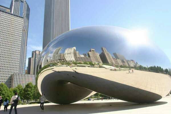 "Chicago's impressive skyline is reflected in British artist Anish Kapoor's Cloud Gate, a sculpture affectionately known as ""the bean"" in Millennium Park. (Tom Uhlenbrock/St. Louis Post-Dispatch/MCT)"