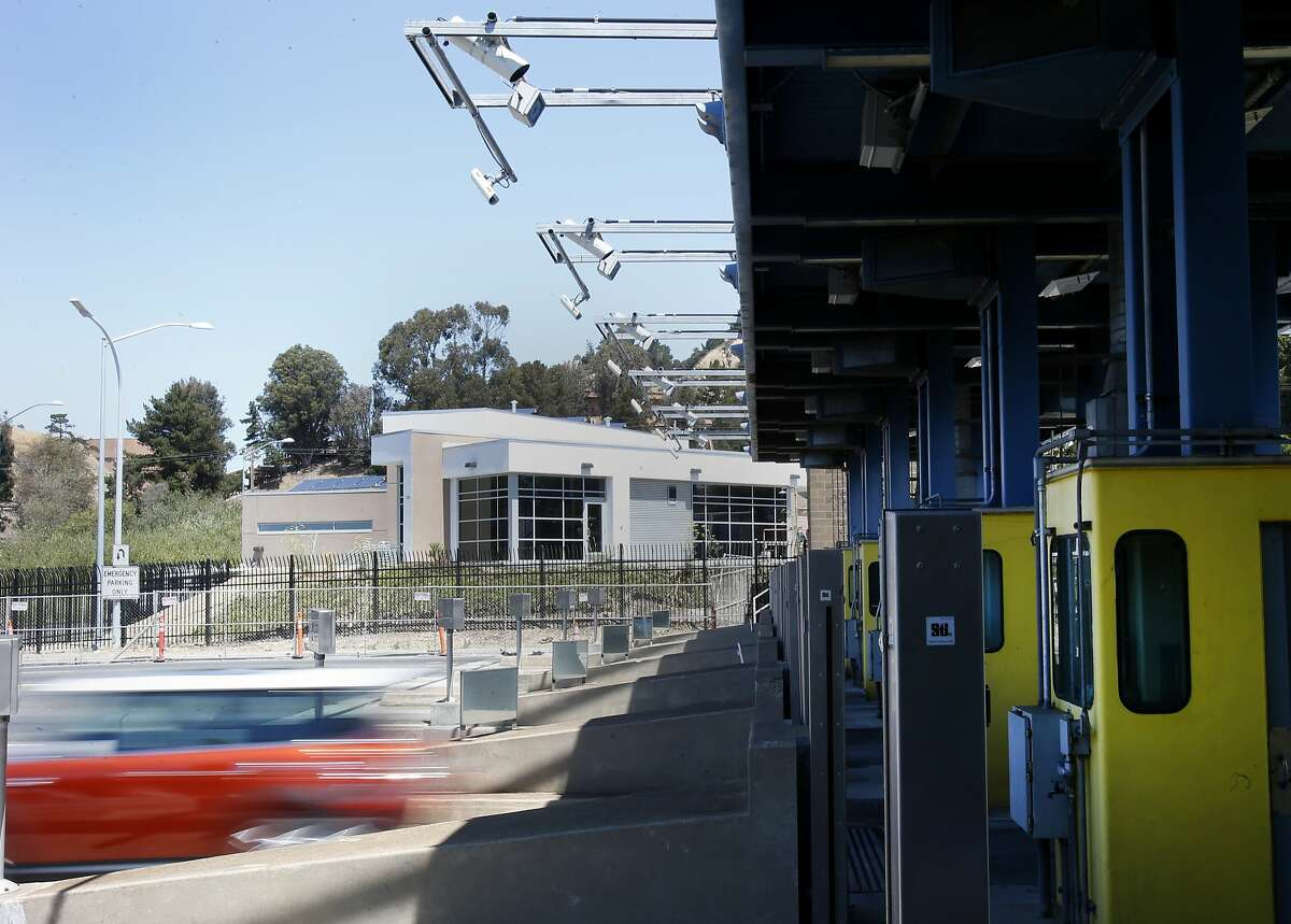 Cameras mounted above the toll plaza (above) are supposed to record license plates as cars speed through the FasTrak lanes Wednesday July 30, 2014. Cameras at some Bay Area bridges are failing to accurately record license plates including the Richmond San Rafael Bridge.