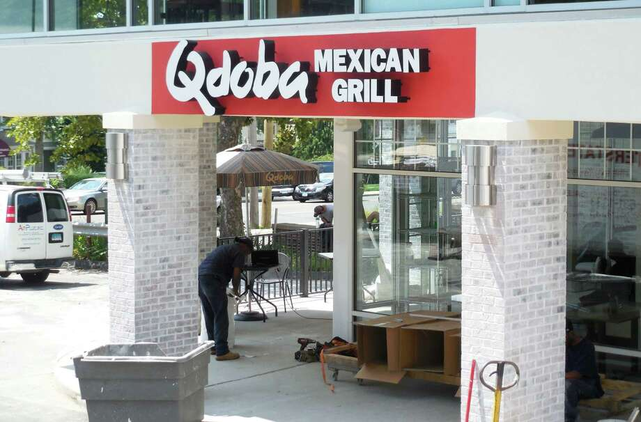 The newest Qdoba Mexican Grill is due to open on Post Road East at Playhouse Square on Aug. 25. Workers have been putting the finishing touches on the restaurant. Photo: Anne M. Amato / westport news