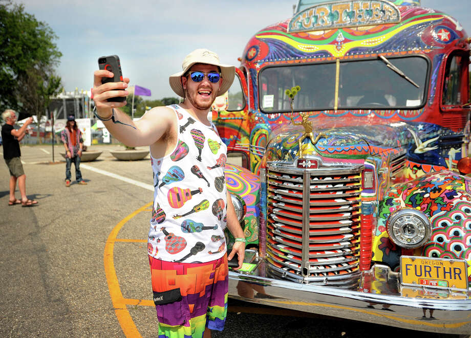 "Ricky Jutkiewicz, of Yardley, PA, poses for a selfie in front of Ken Kesey's ""Further"" Bus, a replica of the original featured in The Electric Kool-Aid Acid Test, the 1968 new journalism classic, at the 19th annual Gathering of the Vibes Musical Festival at Seaside Park in Bridgeport, Conn. on Thursday, July 31, 2014. Photo: Brian A. Pounds / Connecticut Post freelance"