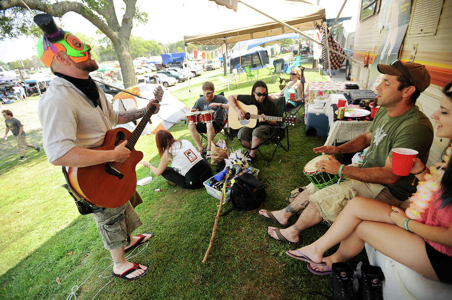 Tommy Doomsday, left, of Ansonia, jams with his band, Electromancer, at their campsite at the 19th annual Gathering of the Vibes Musical Festival at Seaside Park in Bridgeport, Conn. on Thursday, July 31, 2014. Photo: Brian A. Pounds / Connecticut Post freelance