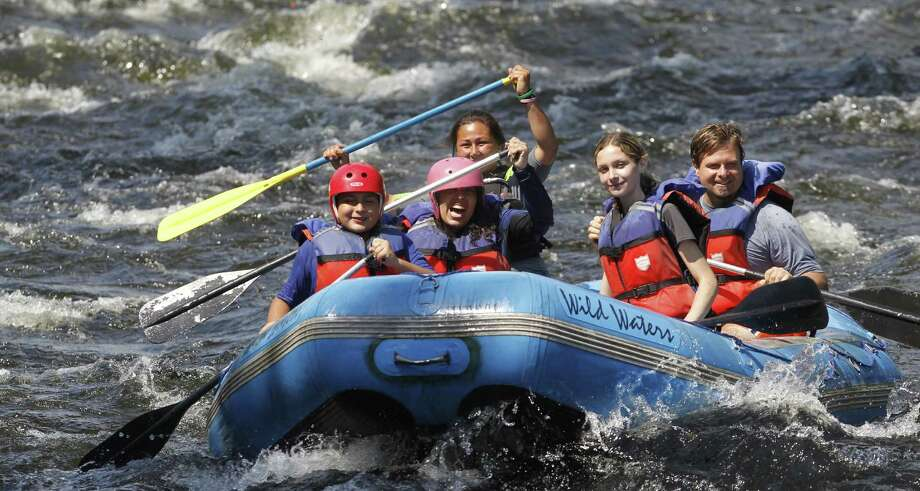 Activities such as whitewater rafting, zip-lining, surfing and stand-up paddleboarding often appeal to teenagers, even when they're not all that excited about vacationing with their parents. Photo: Associated Press File Photo / AP