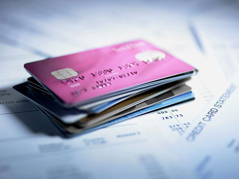 Consumer credit reporting agency EquiFax reports more and more Americans are taking on credit card debt. These are the top 10 cities where residents are jumping on the subprime lending wagon. Photo: Adam Gault, Getty Images  / OJO Images RF
