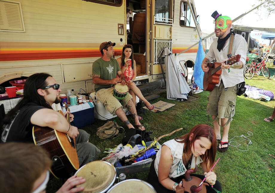 Tommy Doomsday, right, of Ansonia, jams with his band, Electromancer, at their campsite at the 19th annual Gathering of the Vibes Musical Festival at Seaside Park in Bridgeport, Conn. on Thursday, July 31, 2014. Photo: Brian A. Pounds / Connecticut Post freelance