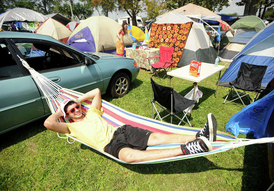 Michael Rabineau, of Stratford, kicks back in his hammock at the 19th annual Gathering of the Vibes Musical Festival at Seaside Park in Bridgeport, Conn. on Thursday, July 31, 2014. Photo: Brian A. Pounds / Connecticut Post freelance