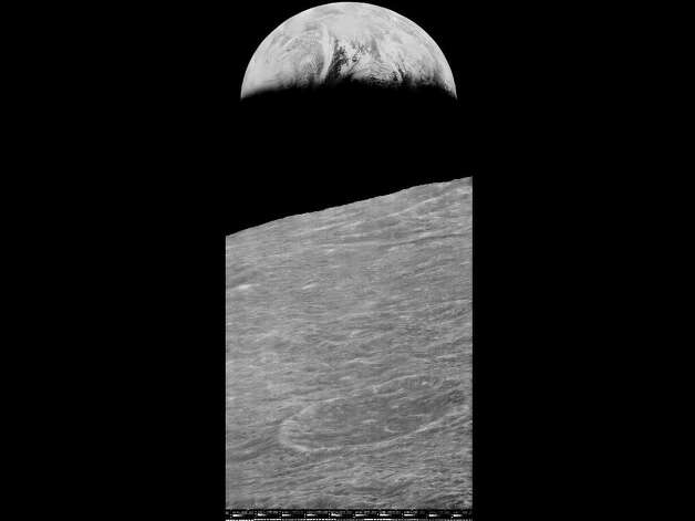MOFFETT FIELD, Calif. -- NASA released a newly restored 42-year-old image of Earth on July 31, 2014. The Lunar Orbiter 1 spacecraft took the iconic photograph of Earth rising above the lunar surface in 1966. Photo: NASA Lunar Orbiter Image Recovery Project