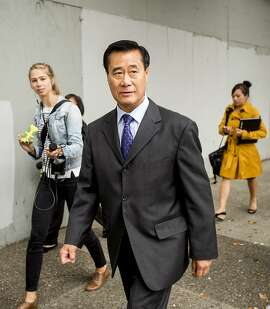 California state Sen. Leland Yee leaves federal court in San Francisco on Thursday, July 31, 2014. Yee, who pleaded not guilty, faces charges including racketeering, bribery, and gun trafficking in an organized crime and public corruption case centered in San Francisco's Chinatown. (AP Photo/Noah Berger)