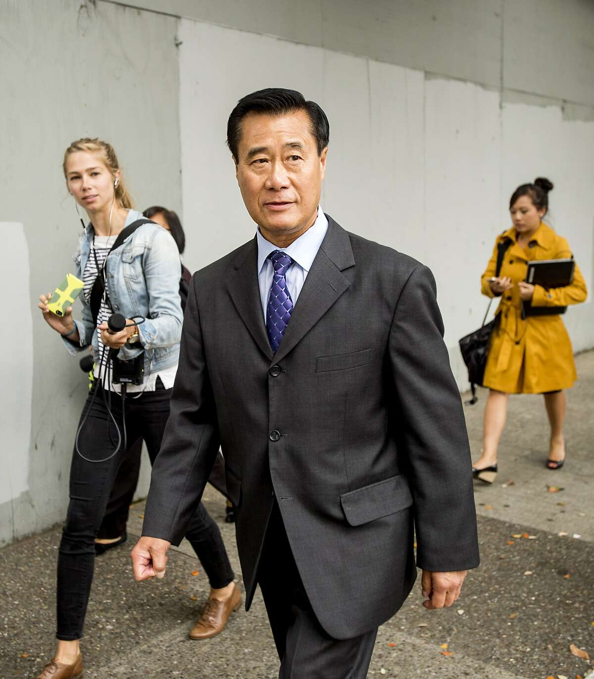 California state Sen. Leland Yee leaves federal court in San Francisco on Thursday, July 31, 2014.