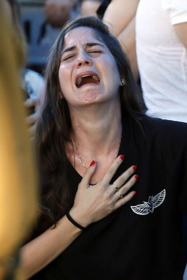 A relative of 21-year-old Israeli St.-Sgt. Matan Gotlib, mourns during his funeral at the military cemetery in the Israeli costal city of Rishon Letzion on July 31, 2014, after he was killed the previous day in combat in the Gaza Strip. Israel said it would not pull troops from Gaza until they finish destroying a network of cross-border tunnels, and the army confirmed mobilising another 16,000 additional reservists, hiking the total number called up to 86,000. AFP PHOTO/ GALI TIBBONGALI TIBBON/AFP/Getty Images Photo: Gali Tibbon, AFP/Getty Images